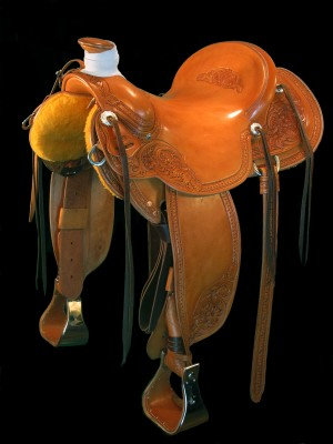 Custom saddle by Cary Schwarz to be given at Wagonhound Production Sale